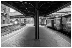 Piercing light (Nodding Pig) Tags: london paddington railway station train england greatbritain uk 2017 class43 dieselelectric locomotive mtu hst highspeedtrain 43124 gwr greatwesternrailway 20170716024r102 film scan monochrome 35mm ilford fp4 nikonfm2 nikkor50mmlens