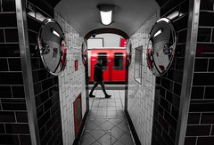 seen (Jonathan Vowles) Tags: selective mono red man london station tube underground passing train mirror reflection tiles lights