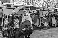 Drive By (Crisp-13) Tags: salisbury market square black white monochrome stall ladies dresses