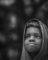 Gaze (mckenziemedia) Tags: boy dreams blackandwhite monochrome lowkey shadows people ethiopia ethiopian face light smile hood bokeh