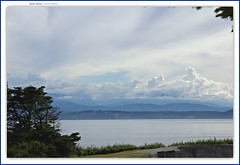 Fort Casey overlooking Puget Sound... (MEA Images) Tags: clouds overcast cloudy mountains hills pugetsound fortcasey washington trees nature canon waterscape waterscene landscape water picmonkey