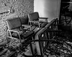 Abandoned South Carolina Mental Hospital: Waiting Area (that_damn_duck) Tags: blackwhite monochrome abandoned urbex urbanexplorer southcarolinamentalhospital asylum hospital debris chairs decaying nikon bw blackandwhite
