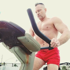 outdoor gym bike cardio (ddman_70) Tags: shirtless pecs muscle outdoor gym bike shortshorts