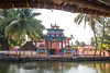 Colourful temple by the Kerala Backwaters (amanda & allan) Tags: india alleppey kerala riceboat riceboats palmtrees palms backwaters veniceoftheeast temple hindu
