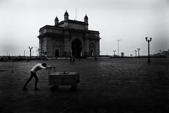City of Dreams (Pavan Chavda) Tags: mumbai street fujifilmx30 pavanchavda light shadows blackandwhite gatewayofindia monument travel india