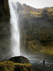 Iceland Waterfall (Kim Nordby Photography) Tags: iceland dreaming green mossy moss lavarock person mist stream river cloudysky overcast rain wonder