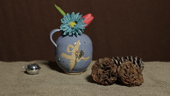 Still Life with Flowers and a Jug (N.the.Kudzu) Tags: tabletop stilllife pottery jug dead camellia flowers silver bell canondslr primelens manualfocus russianlens