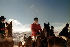 1a-352 (ndpa / s. lundeen, archivist) Tags: nick dewolf nickdewolf photographbynickdewolf 1977 1970s color 35mm film 1a reel1a aspen colorado fall autumn snow november rockymountains foxhunt hunt woodycreek woodycreekhounds roaringforkvalley horse equestrian horses equestrians man redcoat redjacket blackcoat blackjacket hat hats glasses sunglasses gloves jodhpurs boots mountains bluesky rider riders horseback shades roaringforkhounds