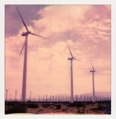 Palm Springs Windmills 1 (tobysx70) Tags: polaroid originals color 600 instant film slr680 windmills palm springs california ca windfarm green alternative renewable energy clouds blue sky mountains vanishing point mojave desert polaroadtrip polawalk 030818 toby hancock photography