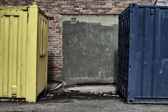 (Delay Tactics) Tags: sheffield yellow blue containers green wall gap space bricks