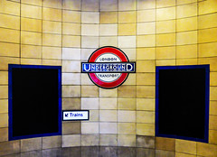 Trains (Steve Taylor (Photography)) Tags: londonundergroundtransport london underground stairs tube architecture sign steps black blue yellow white red down tile uk gb england greatbritain unitedkingdom curve lines train
