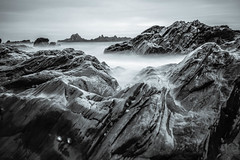 Moon rocks (NikNak Allen) Tags: plymouth devon heybrookbay bay coast beach rock rocks stones sea water ocean light shadows grey greys black white blackandwhite wet pov longexposure seascape smooth sky shapes patterns close wide morning early tide shore