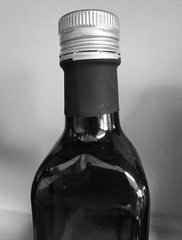 Black And White Bottle. (dccradio) Tags: lumberton nc northcarolina robesoncounty indoors inside food liquid organicoliveoil bottle greatvalue glass bottlecap shadow bw blackandwhite organic oliveoil oil