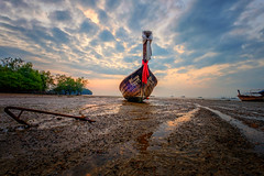 Low tide (Stan Smucker) Tags: boat longtail perspective clouds pov