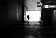 (cherco) Tags: dark lonely solitario solo sombra solitary silhouette silueta shadow street shadows parking light luz luces reflejos reflexions lines lineas alone blackandwhite blancoynegro backlighting tunnel tunel salida exit monochrome canon 60d city composition ciudad man urban urbano