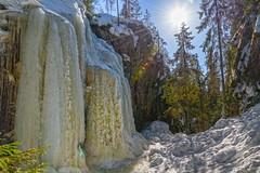 Hitonhauta, frozen water (livejungle) Tags: finland laukaa suomi hitonhauta glacier icicle trees wood suns lensflare spring snow jää jääpuikko jäätikkö lumi kevät d850 ice travel matkailu nikon24120mm ravine gorge