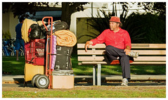A man and his stuff (HereInVancouver) Tags: candid streetphotography homeless lifeonaparkbench vancouverswestend outdoors sunshine people framed canong3x red city urban park vancouver bc canada