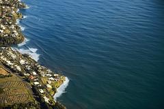 Scalloped Shore (wyojones) Tags: hawaii hilobay hilo shoreline coast shore homes road cemetary ocean sea sand water waves pacificocean trees suburbs blue seacliffs