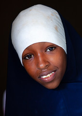 Portrait of a somali young woman in white hijab, North-Western province, Berbera, Somaliland (Eric Lafforgue) Tags: africa african barbara berbera child children day developingcountry documentary eastafrica female girl girls headshot hornofafrica islam lifestyle lookingatcamera muslim onechildonly onegirlonly oneperson outdoors portrait realpeople soma4196 somalia somaliland traditionalclothing vertical northwesternprovince