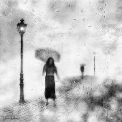 shiver . . . (YvonneRaulston) Tags: rain raindrops wet shower lamp lights umbrella figures girl lady woman street cobblestones atmospheric art artistry bokeh blackandwhite creativeartphotography calm creative dream dusk desaturated digitalart digital emotive evening texture fineartgrunge impressionist impact moody moments mist mysterious monochrome old sony soft road path photoshopartistry peaceful person people surreal vignette vintage