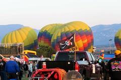 A Very Jolly Roger (Patricia Henschen) Tags: balloonliftoff balloonclassic hotairballoon prospect lake memorialpark park prospectlake colorado coloradosprings downtown laborday labordayliftoff balloon balloons morning dawn