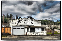 Jakes Used Cars (NoJuan) Tags: hwy99 olympusartfilter olympus1250mmf3563 olympuspenf microfourthirds micro43 m43 washingtonstate washingtonstatedowntowns abandoned neglected sign itsasign