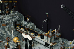 04_Endarmire_Iron_Mine (LegoMathijs) Tags: lego moc legomathijs steampunk mine miners mining rocks iron ore steampowered drones tracked driller flying discovery vehicle explorer speeder transporter transport airship clockwork drone speeders walking steamcopters pickaxe tools crates shaft cranes workshop gears cave docks