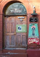 Bisbee's Itty Bitty Bar (Maureen Medina) Tags: maureenmedina artizenimages bisbee az arizona historic miningtown southern silverking hotel door wooden old entrance brick building bar signs room 4 smallest