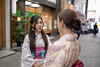 Young female friends in Kimono talking in city street (Apricot Cafe) Tags: img87317 asakusa asia asianandindianethnicities japan japaneseethnicity japaneseculture kimono multiethnicgroup tamronsp35mmf18divcusdmodelf012 tokyojapan candid capitalcities carefree colorimage cultures day facetoface friendship happiness leisureactivity lifestyles longhair outdoors people photography shoppingmall smiling springtime straighthair street talkingwaistup togetherness tourism tourist tradition traveldestinations twopeople weekendactivities women youngadult