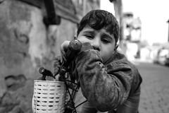 Child... (K.BERKİN) Tags: eye turkey tourism human oldcity oldistanbul oldstreet people portrait street streetphoto streetphotograpy goldenhorn kid kidgame life leica blackwhite istanbul city child children bosphorus nature mirroless boy