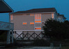 (Jeremy Whiting) Tags: orange reflection dusk sunset sun windows reflect night glass blue dark available light canon digital holden beach north carolina ocean atlantic condo resort town travel