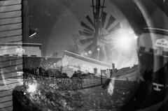 [ .   naked lunch frame 3823f   . ] (ǝlɐǝq ˙M ʍǝɥʇʇɐW) Tags: film lomo multiple exposure 35mm texas tilting windmill fisheye remix mrtrona grain sun