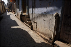 noon, gokul (nevil zaveri (thank U for 15M views:)) Tags: zaveri people uttarpradesh up india gokul photography photographer images photos blog stockimages photograph photographs nevil nevilzaveri stock photo architecture exterior vrajbhoomi street sunlight sunlit shadows wall
