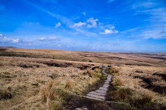The Pennine Way at Redmires Bog (rustyruth1959) Tags: nikon nikond5600 tamron16300mm uk england yorkshire lancashire moorland greatermanchester mossmoor windyhill pennineway footpath grass m62 motorway bridge sky clouds walk outdoor mud landscape moor slabs stones water bog puddle redmiresbog