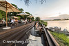 A group of hotel guests of the Royal Livingstone Hotel sit on the sundeck and watch the sun set over the Zambezi River Livingstone, Zambia (Remsberg Photos) Tags: zambia africa theroyallivingstonehotel luxury zambeziriver sunset goldenhour water viewingdeck tourists travel leisure relaxation landscape picturesque view sundeck livingstone