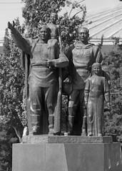 Generations (peterkelly) Tags: bw digital canon 6d kyrgyzstan asia gadventures centralasiaadventurealmatytotashkent bishkek statue victorymonument victorysquare generations father son daughter family