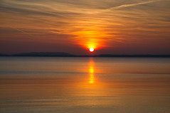 Sunset over the water (echumachenco) Tags: sunset sun evening march sky cloud red orange pink sunsetcolors water lake reflection landscape outdoor serene chiemsee upperbavaria oberbayern bavaria bayern germany deutschland nikond3100
