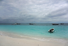 Rain clouds cleared the beach (Francoise100) Tags: zanzibar shore beach plage strand aqua water horizon clouds boats empty landscape landschaft landschap island africa afrika afrique ocean sea sand sky cloudy insel tropics tropical