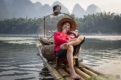 Relax (lc99photography) Tags: cormorant cormorantfisherman cormorantfishing relax raft bambooraft karst karstformation man red oldman bird water lijiang liriver travel china guilin nature landscape