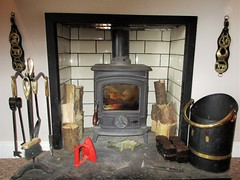 Home is where the hearth is (JulieK (thanks for 6 million views)) Tags: macromondays fireplace hearth 2018onephotoeachday stanleystove horsebrasses iron dust ash home indoors flame wood tiles wall