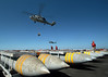 sikorsky h-60 (San Diego Air & Space Museum Archives) Tags: ammo bombs sh60f sh60 seahawk hs75 emeraldknights vertrep ammooffload offload ammuniion ordnance flightdeck kennedy cv67 taoe6 supply usns msc ordies usa bomb aerialbomb aerialbombs