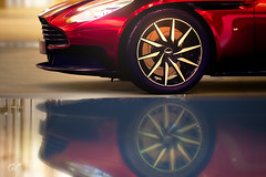 The Part (Mr. Pebb) Tags: astonmartin db11 british part portion side headlight red reflections reflection dof depthoffield supercar grandtourer gt car twodoor 2door coupe 2seater twoseater fr frontengined rearwheeldrive rwd v12 wheel rim vents vent grill granturismosport granturismo pd polyphonydigital sony sonyinteractiveentertainment ps4 playstation4 photomode videogame racinggame racegame scape indoor water badge blurred