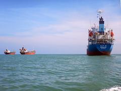Three Ships in Phuket Bay (Tim Aldworth) Tags: oiler oiltanker ship ships phuket thailand anchor atanchor vessels sea water boats merchantship