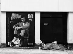 Run the Streets - or Sleep Them? (Feldore) Tags: homeless bath street sleeping england english poverty rich advertising bag contrast feldore mchugh em1 olympus 1240mm documentary