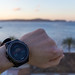 Smartwatch showing sunrise, sea in the backgroung