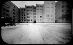 Blocks (batuda) Tags: pinhole obscura stenope lochkamera analog analogue tin altoids mediumformat paper kodak polymax d76 11 wide wideangle bw blackandwhite monochrome winter snow house architecture building sky windows blocks žaliakalnis kaunas lithuania lietuva neodymium