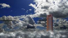 Skyscraper - Rascacielo (ricardocarmonafdez) Tags: arquitectura architecture buildings rascacielos skyscraper cielo sky nubes clouds sunlight blue azul effect edition processing torre tower torresevilla pelli 60d 1785isusm canon