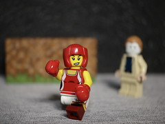 The Lady Kickboxer has just signed with a new promoter and he's come to the farm to watch her work out (N.the.Kudzu) Tags: tabletop lego minifigures lady kickboxer canondslr lensbabyburnside35