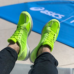 Brightly colored green ASICS running shoes thumbnail