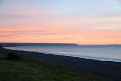 Bay View Dawn (Karen Pincott) Tags: sunrise dawn napier sea autumn sky clouds beach newzealand firstlight bayview coast ocean water